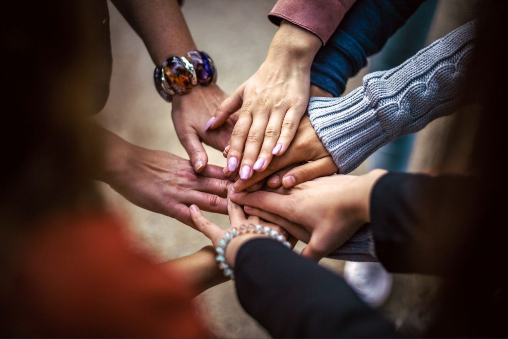 Live Events, The Cannabis Community, and How We Stay Connected in Today's Reality featured blog post image - group of people with hands touching