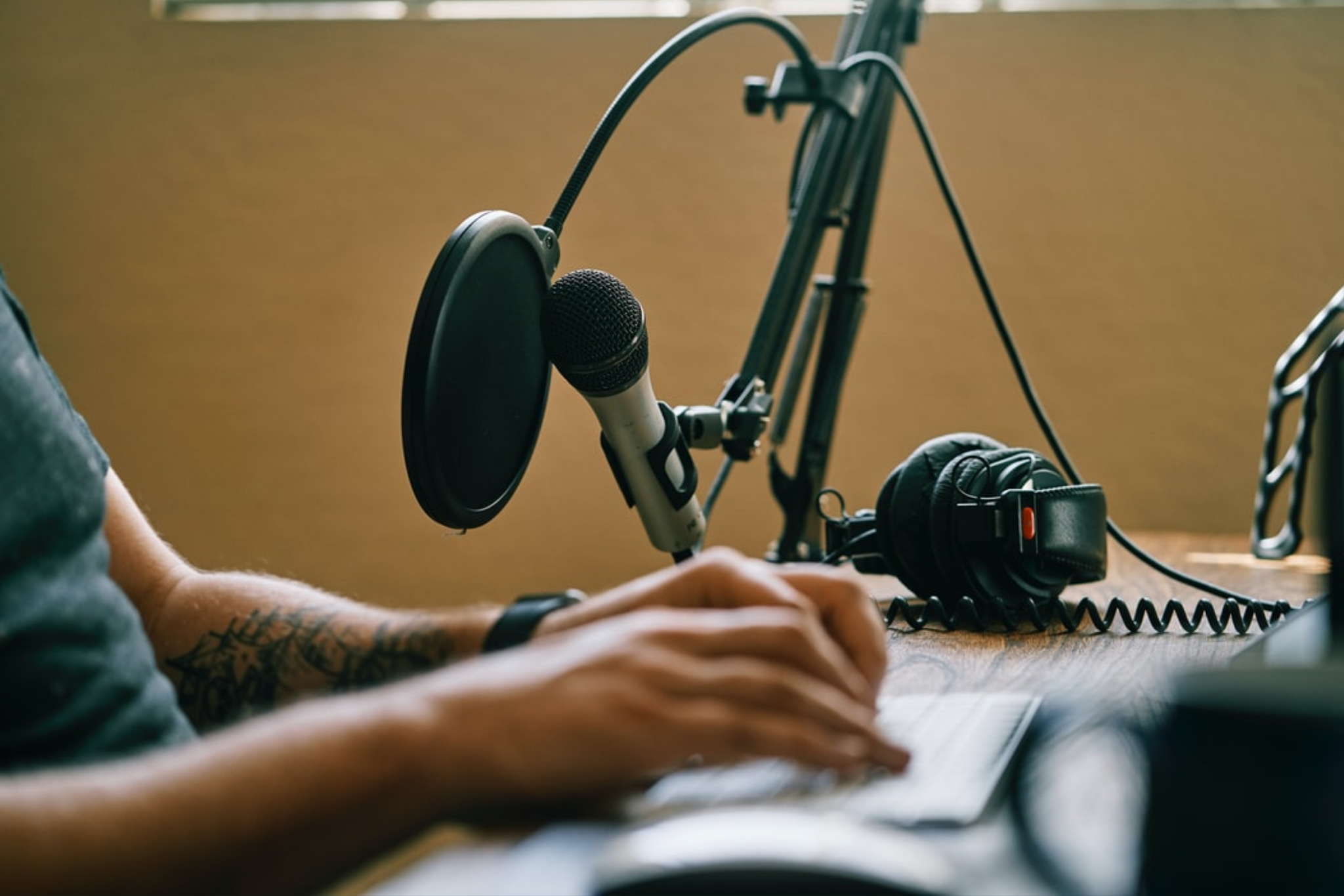 podcaster recording a show with microphone in front